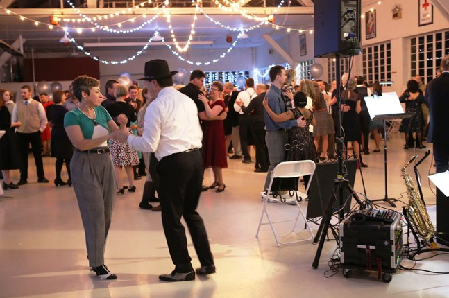 couples dancing in a social setting are not lonely