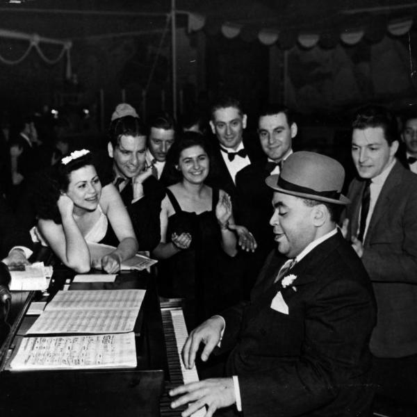 Fats Waller playing Ain't Misbehavin' at a party.