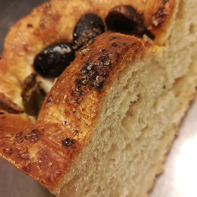 We're now offering savoury snacks to complement the drinking chocolate and tea at our café. How about OLIVE ROSEMARY FOCACCIA served with chocolate-infused extra-virgin olive oil?#chocolatier #chocolatecafe #cafe #focaccia #bread #manchesternh