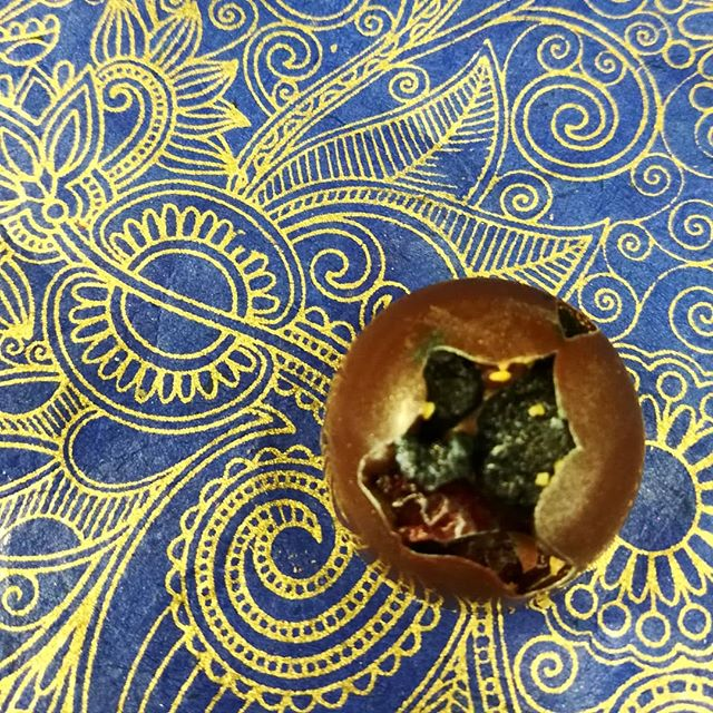 IT JUST IS (what it is) - New England Cranberries and blueberries with fenugreek in dark milk chocolate.#chocolatier #chocolatecluster #newengland