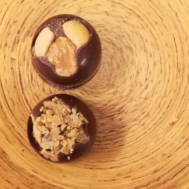 JUST NUTS - (upper) roasted peanuts and maple sugar. (lower) cashew buttercrunch and caramel.#chocolatier #peanuts #maple #cashews #caramel #darkmilkchocolate