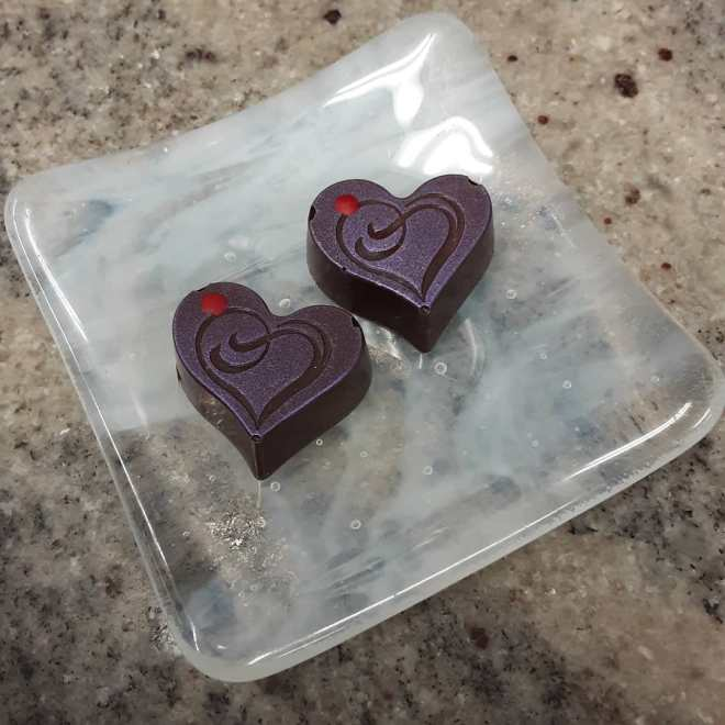 PASSION. - apricot passionberry ganache with blood orange cloud caramel, capped with yuzu chocolate. #chocolatier #valentines #heart