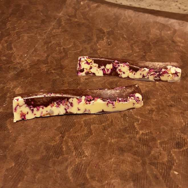 TWO AS ONE: red fruit marshmallow in a white and dark shell scattered with rose petals #chocolatier #rose a time of romance and affection, appearing in all that's done, two were just that, before becoming one