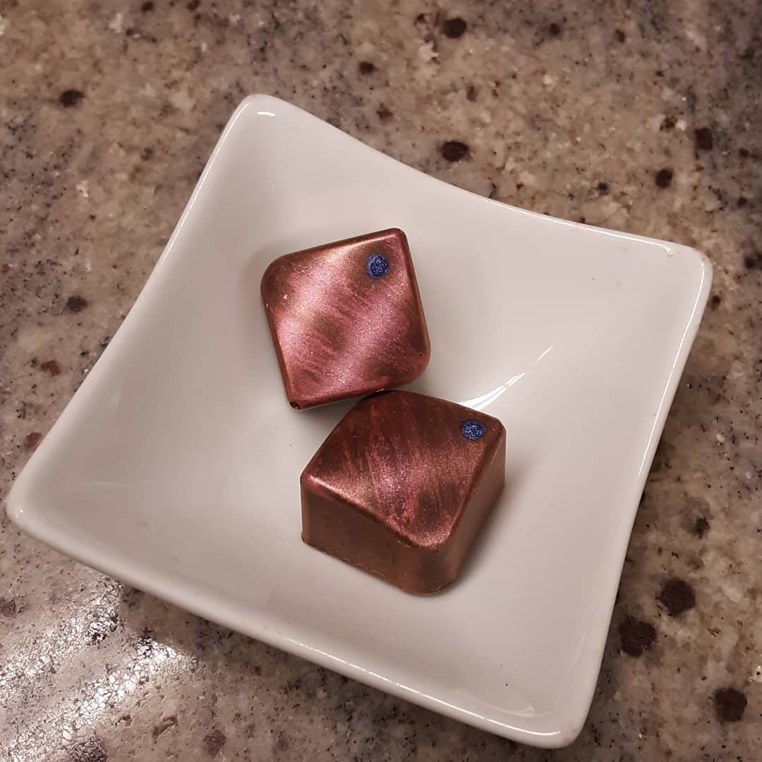 TUBES OF NEON: apricot Ceylon tea marshmallow in tart dark milk chocolate #chocolatier #neon #marshmallow Glass bends, enhances thoughts, fills in vibrancy, words emerge, in tubes of glass.