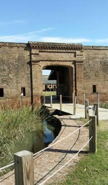Entrance drawbridge and moat.