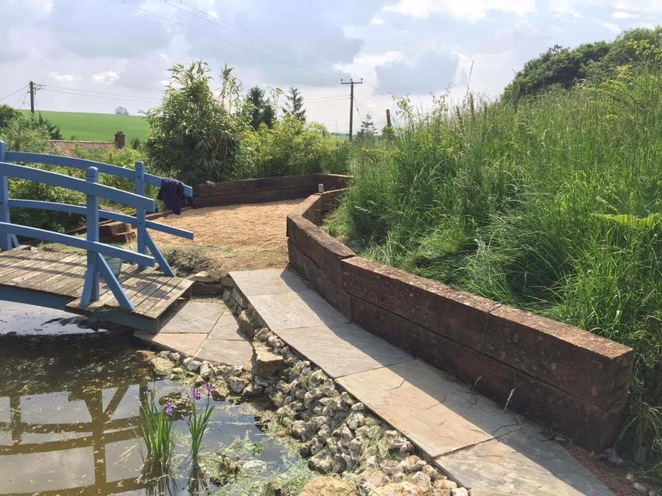 Garden pond and mini foot bridge Wiltshire