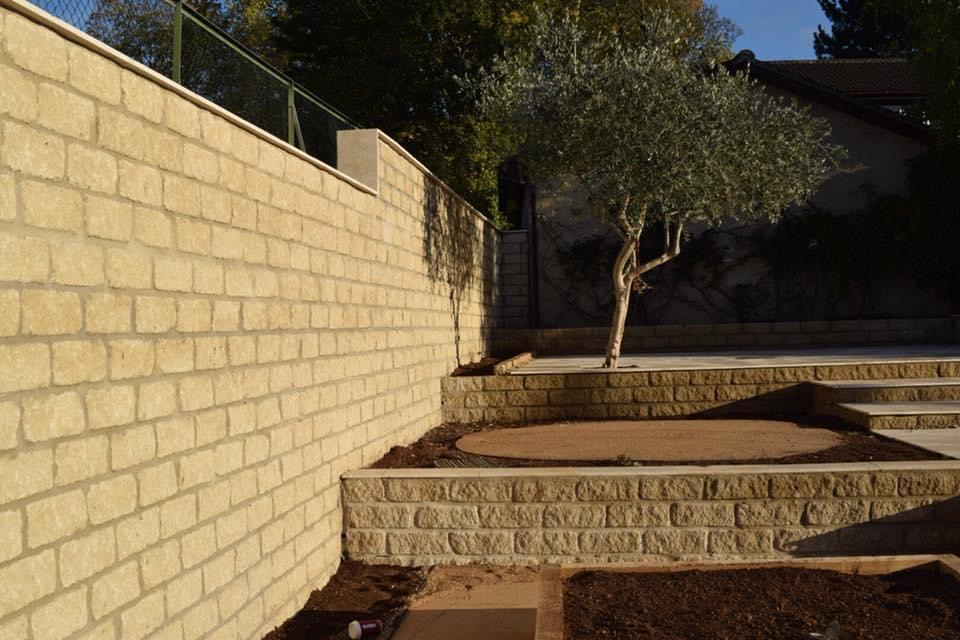 Stone wall and stone raised flower bed