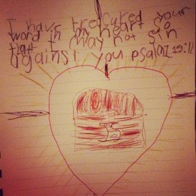 Josh's (1st Grade) illustration: a scroll (God's word) in a treasure box in a heart and in a cross.