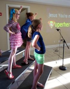energetic kids leading worship