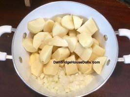 Place onion, potatoes and salt into a pot.