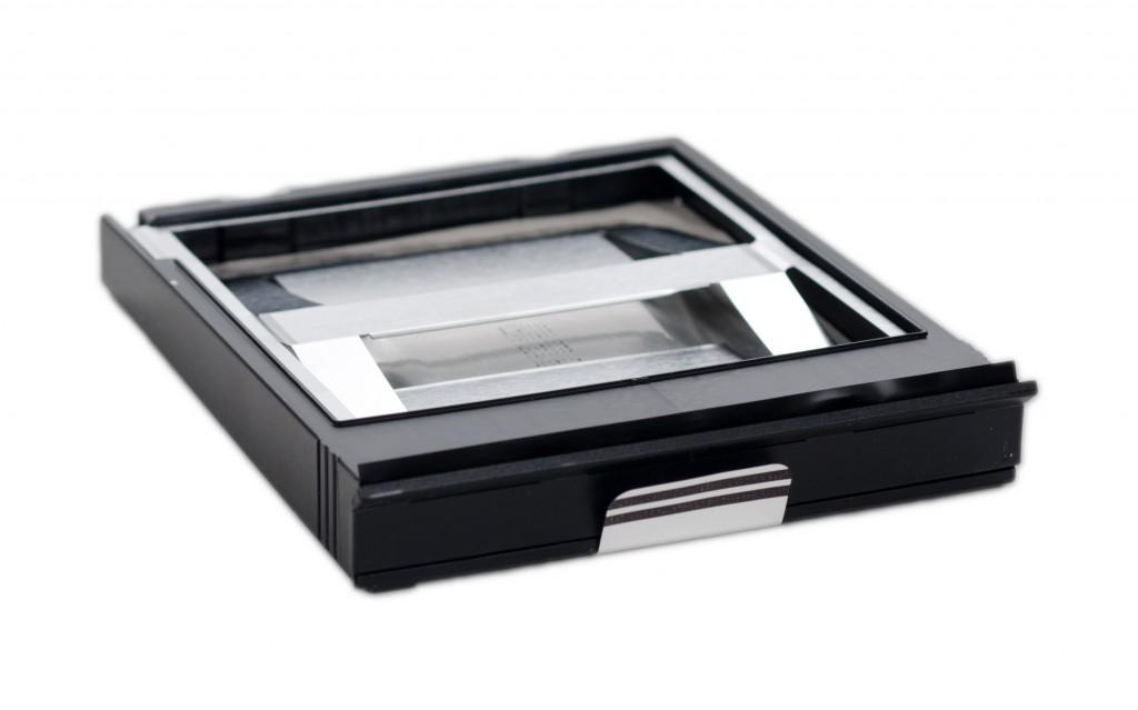 An empty Polaroid film cartridge