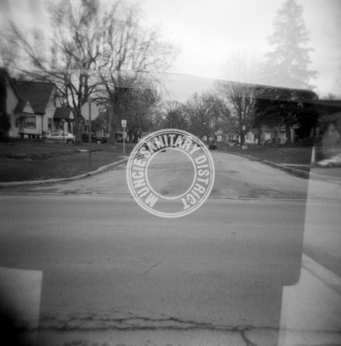 Medium format produces negatives so big that it's unnecessary to milk every pixel/grain like in 35mm. This is especially true with Holga and Lomography, where the goal certainly isn't sharpness. The above image was scanned with a flatbed scanner, resulting in plenty sharpness and a massive file that can easily be printed.