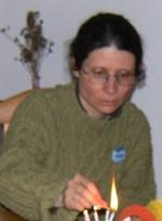 Adriana Mugnatto-Hamu lighting a candle