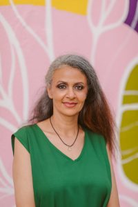 Toronto-Danforth candidate Maryem Tollar in front of a pink wall
