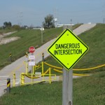 dangerous-intersection-sign-on-bike-trail