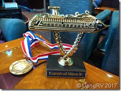 24 kt gold plated plastic ship on a stick and medal