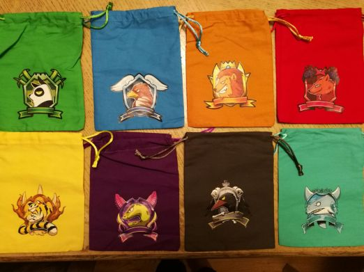 Cute little baggies for you to pick your guild colour and icon - this is where we store our team and figures