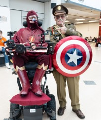 Daniel Baker dressed as the Flash with a Welsh Stan Lee Cosplayer