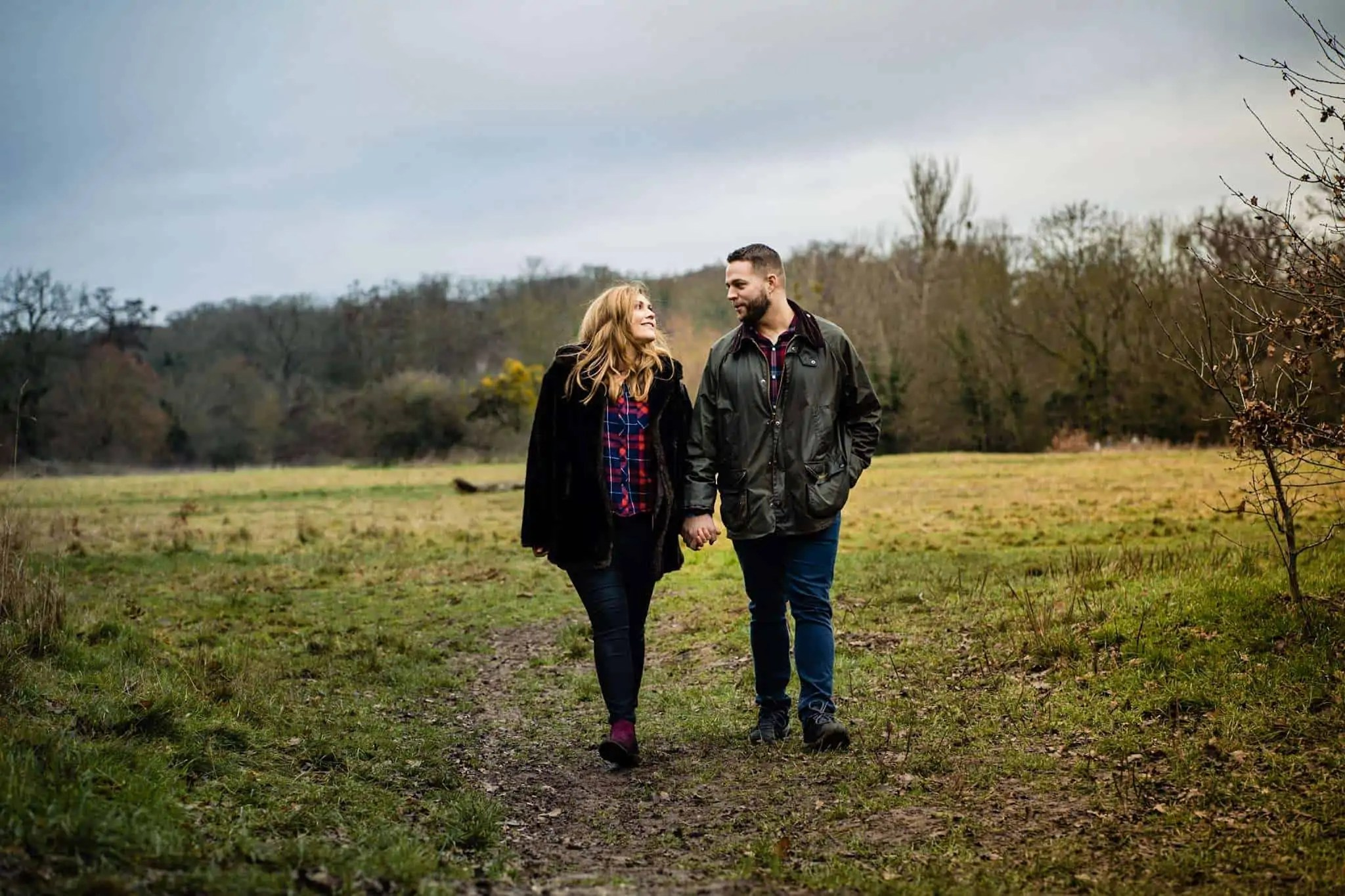 An engaged couple enjoying a walk in north London