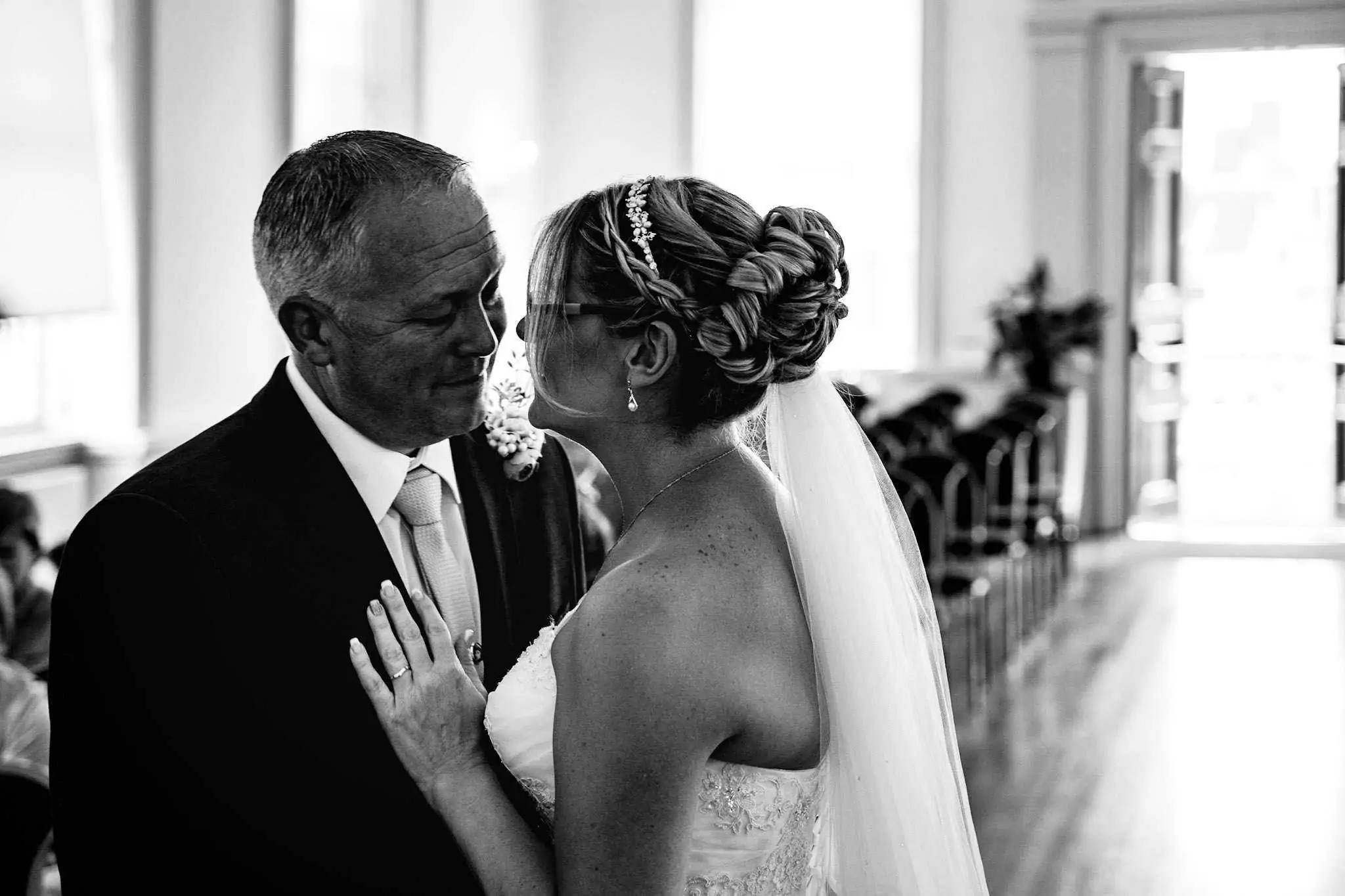 A bride and groom have their first kiss at Poole Guildhall