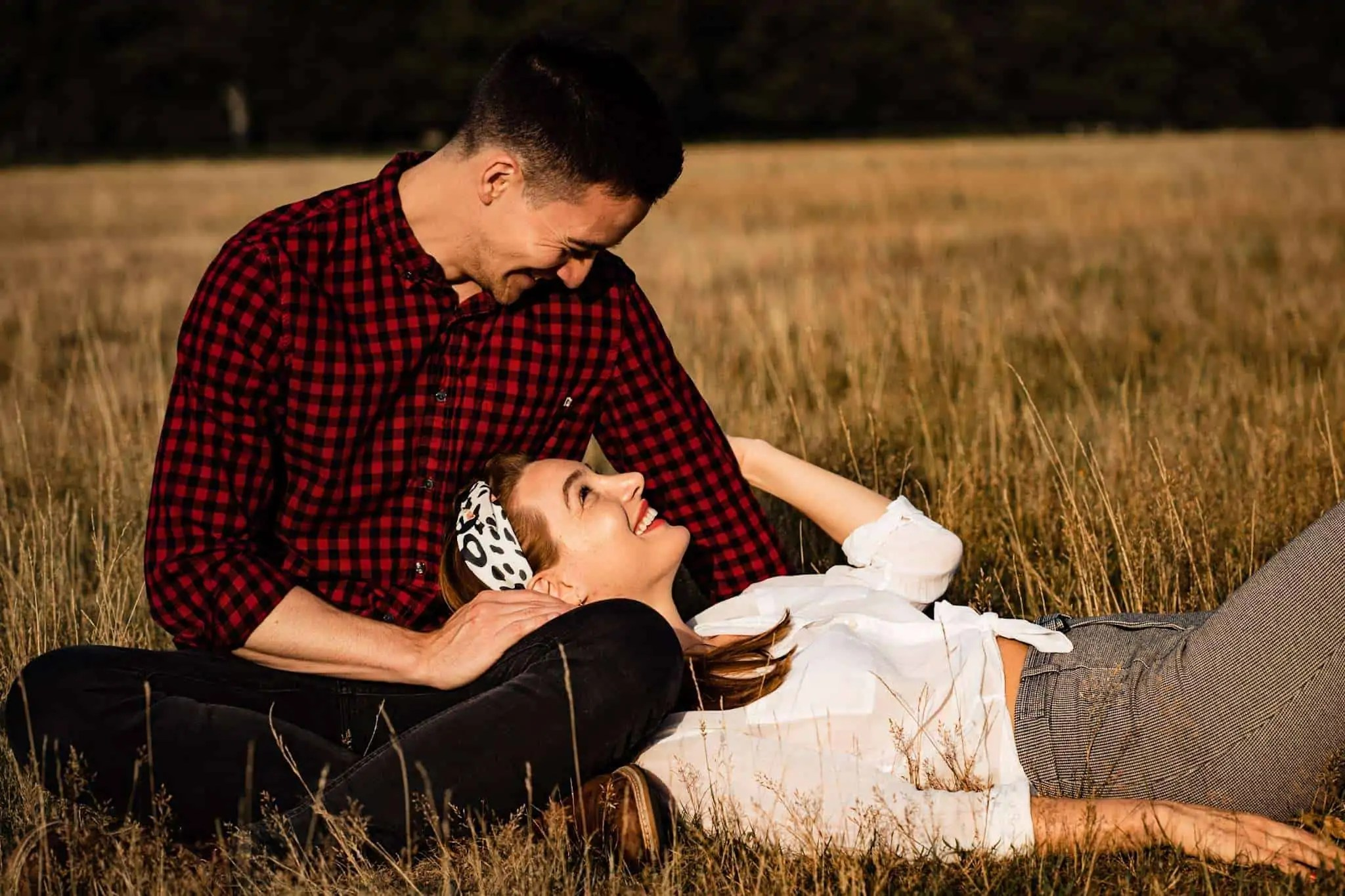 An engaged couple relaxing in Richmond Park