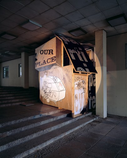 "Daniela Brahm Recycling Utopia, 2006 a hut in a public passageway build out of the paintings remaining from the installation ""The New Town"" in Zamosc, approx. 3.3 x 3.5 x 2.5m"