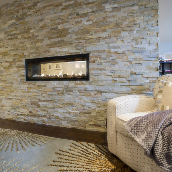 Contemporary Fireplace Featuring Cultured Stone Surround
