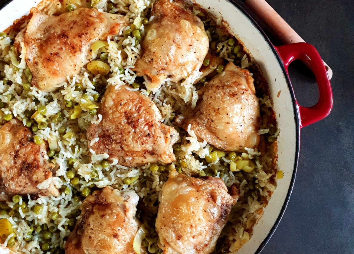 Roast chicken thighs with braised rice and peas