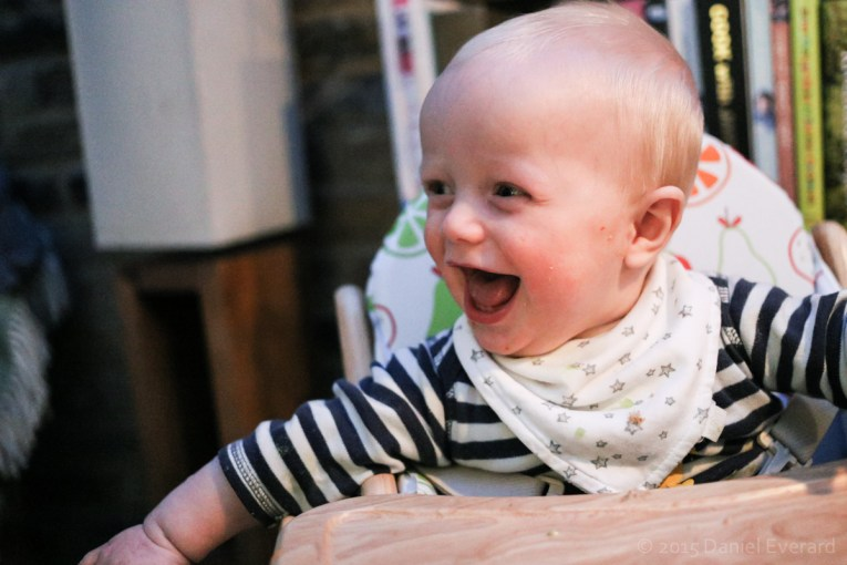 Child laughing at dinner time