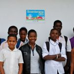 A group of students outside the school