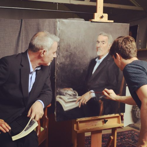 Mark watching his own portrait coming to life