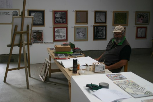 Tim surrounded by his current exhibition at the Mid Wales Art centre