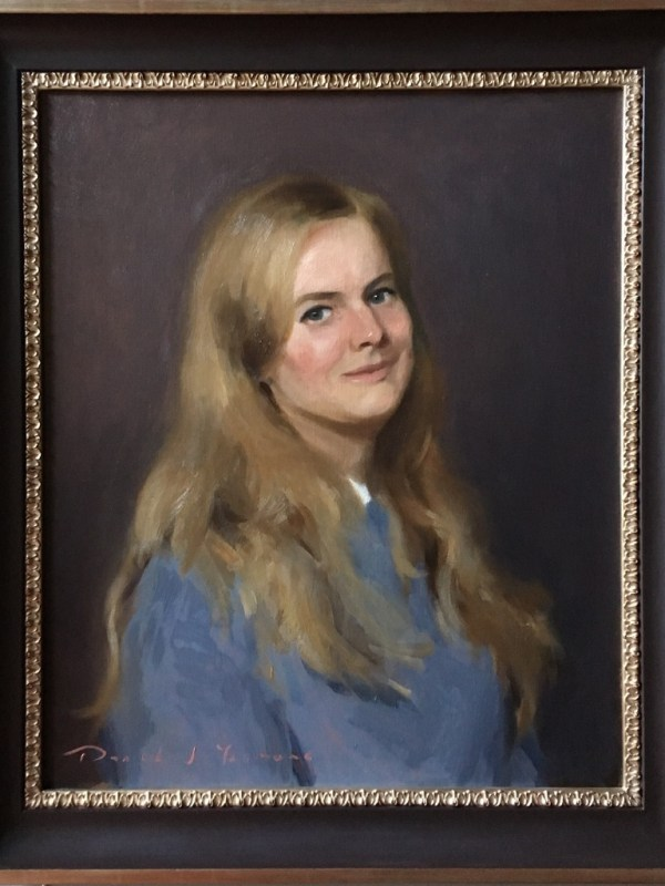 a framed portrait painting of my friend Emily