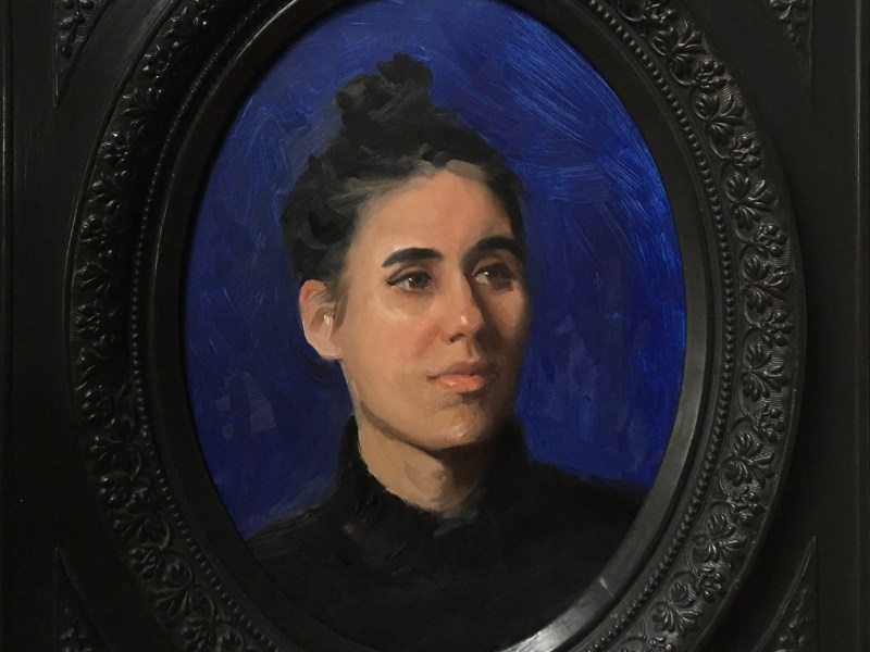 portrait painting in old victorian oval frame