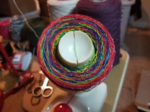 hand painted rainbow yarn being wound