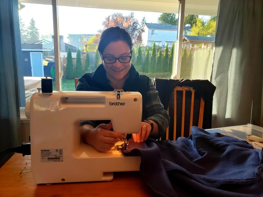 Jess learning to sew pillowcases