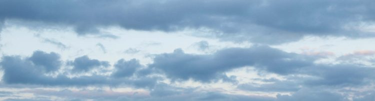 Background image of dark blue sky with clouds.