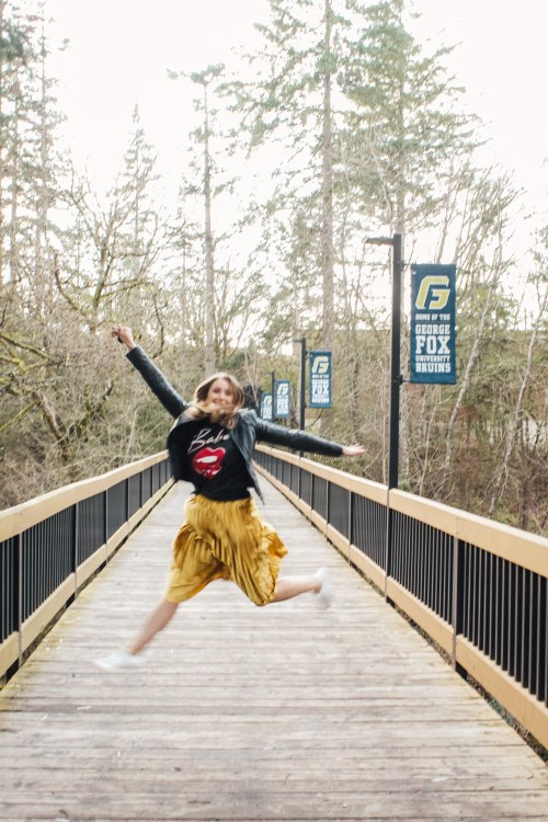 band tee leather jacket and gold skirt jumping - Danielle Comer Blog