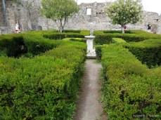 A garden in the ruins of wealthy estate in Pompeii