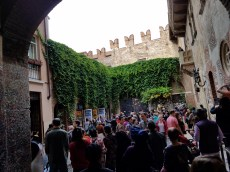 Courtyard at the purported home of the Capulets (Casa di Giulietta) in Verona. Juliet's balcony is on the right.