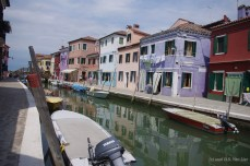 Brightly colored homes along a canal in Burano