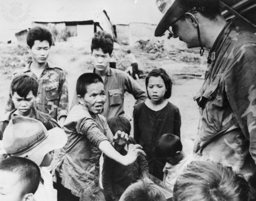 9VT-1969-11-27-A1 Vietnam War / Mutilated Vietnamese woman Indochina Wars / Vietnam War 1964-75. Survivors of the village Tu Cung in the Mekong Delta, accuse the US infantry of killing 567 unarmed men, women and children on 16 March 1968. - A survivor shows her mutilated hands to a US soldier. - Photo, 27 November 1969.