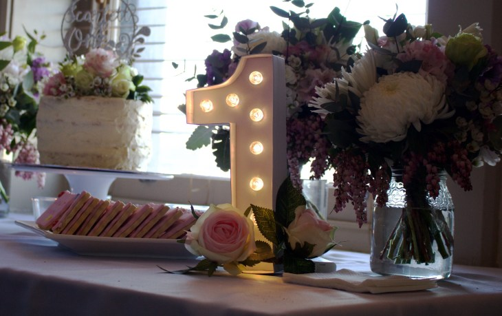 first birthday party table setting number one light winter florals winter posies