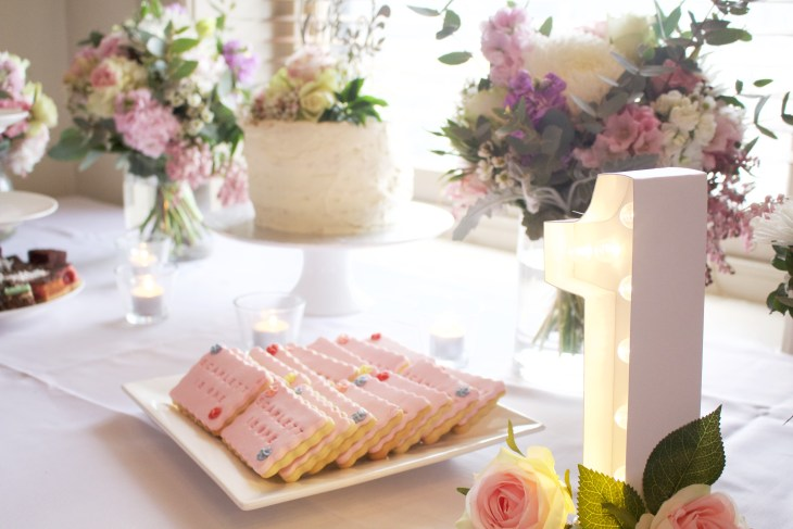 first birthday party table setting winter posies best sugar cookies number one light