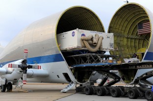 The heat shield for NASA's Orion spacecraft was loaded onto a Super Guppy plane in Manchester, N.H. on Dec. 4, for transport to Kennedy Space Center in Florida. The heat shield, the largest of its kind ever built, is being unloaded Thursday, Dec. 5, and is scheduled for installation on Orion in March 2014. The heat shield will be used in September 2014 during Exploration Flight Test-1, a two-orbit flight that will take an uncrewed Orion capsule to an altitude of 3,600 miles. The returning capsule is expected to encounter temperatures of almost 4,000 degrees Fahrenheit as it travels through Earth's atmosphere at up to 20,000 mph, faster than any spacecraft in the last 40 years. Data gathered during the flight will influence decisions about design improvements on the heat shield and other Orion systems, authenticate existing computer models, and innovative new approaches to space systems and development. It also will reduce overall mission risks and costs for future Orion missions, which include exploring an asteroid and Mars.