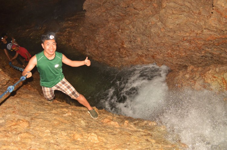 Climbing the first waterfall in Aran Cave, Tuba.