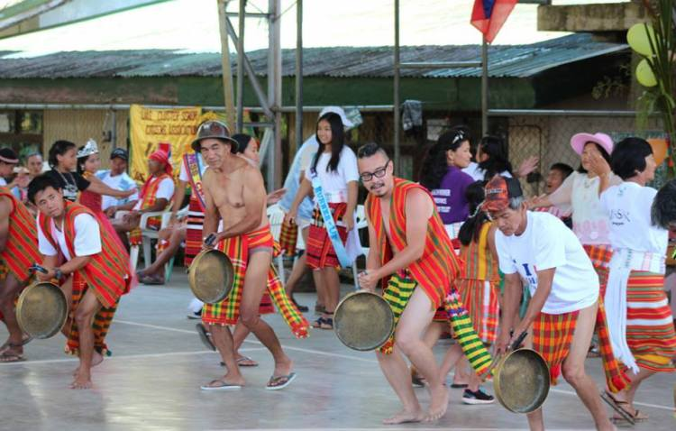 Locals in Lias showing the Igorot Costume for Male and Females during a cultural festival.