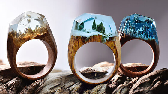 Miniature fantasy worlds within wooden rings