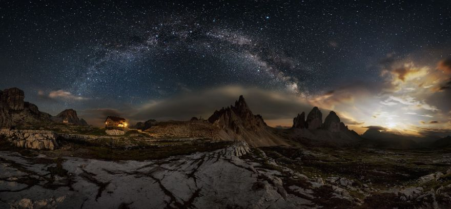 Panoramic view with the moonset at The Three Peaks of Lavaredo (Italy), also called Drei Zinnen, on a night in July at 2450m, during a photographic weekend with some landscaper friends.