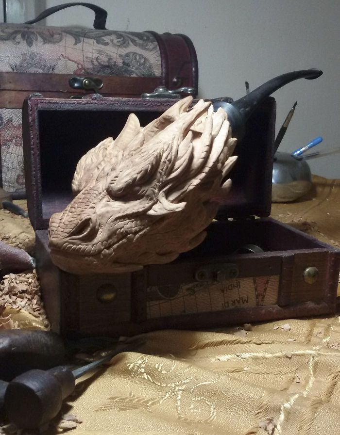 Sculptor turns blocks of wood into intricately detailed pipe of Smaug